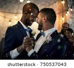 Gay Couple Dancing On Wedding...