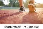 runner athlete feet running on...   Shutterstock . vector #750586450