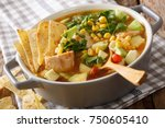 spicy tortilla soup with... | Shutterstock . vector #750605410
