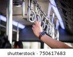 hand of passenger holding in...   Shutterstock . vector #750617683