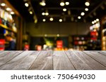 closeup top wood table with... | Shutterstock . vector #750649030