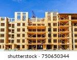 six storey frame building under ... | Shutterstock . vector #750650344