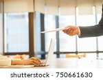 Small photo of close up businessman(manager) hand give white-letter to businesswoman(employee) for layoff or manager send secret envelope to employee in private room about corruption, business situation concept