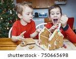 children eat gingerbread house...   Shutterstock . vector #750665698