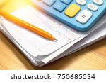 pen and calculator on household ... | Shutterstock . vector #750685534