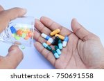 mans hands with pills on