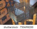 shopping basket. iron basket in ... | Shutterstock . vector #750698200