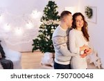 hugging couple on christmas | Shutterstock . vector #750700048