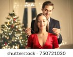 handsome guy gifting a... | Shutterstock . vector #750721030