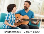 the father teaches his son to... | Shutterstock . vector #750741520