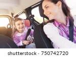 cute young girl in a car with...   Shutterstock . vector #750742720