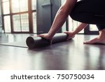 yoga concept. young men rolling ... | Shutterstock . vector #750750034