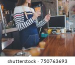 young asian woman barista with... | Shutterstock . vector #750763693