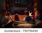 family enjoying movie night at...   Shutterstock . vector #750796450
