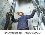machinist with measure tape... | Shutterstock . vector #750796930