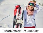 sporty female holds snowboard... | Shutterstock . vector #750800089