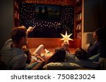 family enjoying movie night at... | Shutterstock . vector #750823024