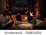 family enjoying movie night at... | Shutterstock . vector #750823333