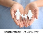 Stock photo woman holding wooden figure of family close up 750843799
