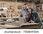 two wood designer working with... | Shutterstock . vector #750849304