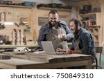 two wood designer working with... | Shutterstock . vector #750849310