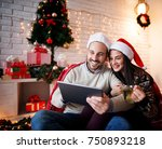 cute smiling couple sitting on... | Shutterstock . vector #750893218
