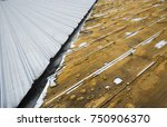 damaged roof as a background. ... | Shutterstock . vector #750906370