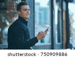 business man smiling looking... | Shutterstock . vector #750909886