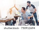 a colleague rolls a person in a ... | Shutterstock . vector #750912694