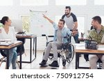 a colleague rolls a person in a ... | Shutterstock . vector #750912754