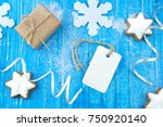 Small photo of Christmas and New year gift on the wooden background. Blank white gift tag for your text