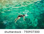 beautiful woman swimming at the ... | Shutterstock . vector #750937300