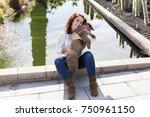 beautiful young woman hugging...   Shutterstock . vector #750961150
