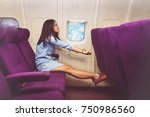 asian woman passenger relaxing... | Shutterstock . vector #750986560