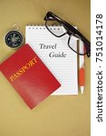 Small photo of Conceptual photo of travel planning using relevant items. Selective focused, isolated on brown wooden background.