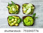 fresh avocado toasts with... | Shutterstock . vector #751043776
