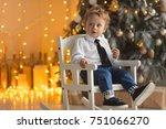 happy little boy sitting near... | Shutterstock . vector #751066270