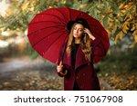 beautiful girl in claret coat... | Shutterstock . vector #751067908