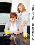 daughter soothes sad mother.... | Shutterstock . vector #751087888