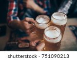 happy male friends drinking... | Shutterstock . vector #751090213