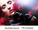 attractive woman with red rose - stock photo