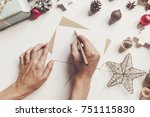 hands holding pencil and...   Shutterstock . vector #751115830