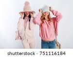 two cute girls covering their... | Shutterstock . vector #751116184