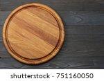 round wooden plate on dark... | Shutterstock . vector #751160050