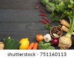 fresh vegetables on dark wooden ... | Shutterstock . vector #751160113