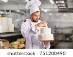 chef pastry decorates cake in... | Shutterstock . vector #751200490