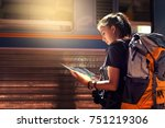 Stock photo asian tourists see the map after getting off the train to trave 751219306
