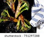 roasted broccoli on a black... | Shutterstock . vector #751297288