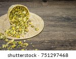 Small photo of Chrysanthemum tea on wood background, Extend the arteries at the heart. Help prevent artery diseases such as hypertension, angina.It absorbs.