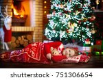 child sleeping at fire place on ... | Shutterstock . vector #751306654